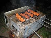 humorous photo of shishkebabs on the case of a burned-out computer