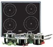 An induction cooktop with stainless-steel pots and pans.